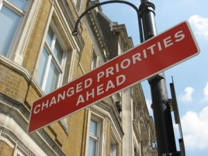 change priorities ahead sign
